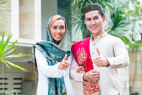 3763dffc5 Asian Muslim couple wearing traditional dress - Buy this stock photo ...
