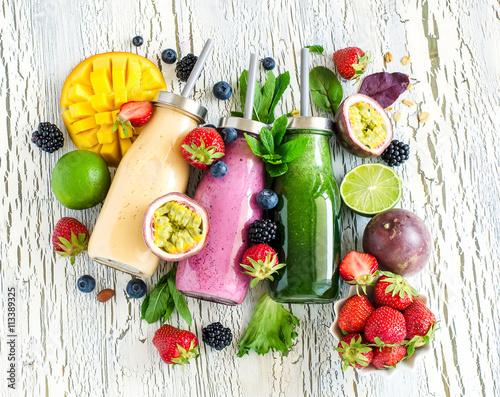 Fotobehang Sap Berry and fruits smoothie in bottles, healthy summer detox drink