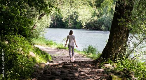 Tableau sur Toile Girl on a hiking trail near the river Brenta in Bassano del Grappa