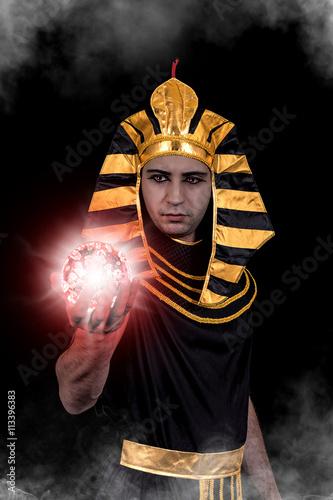 Pharaoh with radiant glass ball Fototapeta