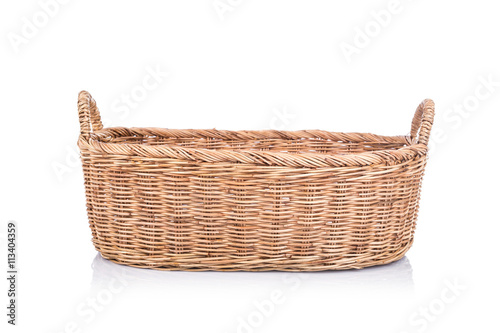 Handmade rattan basket isolated on white background Fototapete