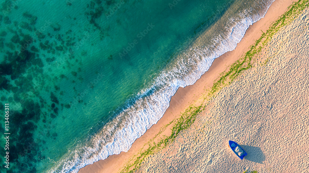 Valokuva  Aerial view of ocean waves and sand on beach