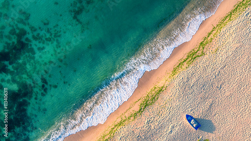 Poster Luchtfoto Aerial view of ocean waves and sand on beach
