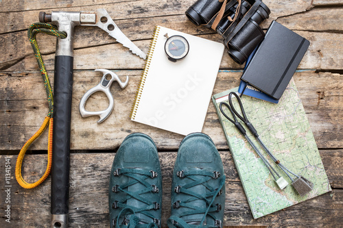 Photo Climbing tools with boots on wood background