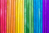 Fototapeta Tęcza - Abstract gay pride rainbow spectrum background on textured layered wood