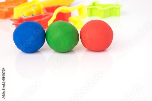 Ball shape of play dough on white background. Colorful play doug