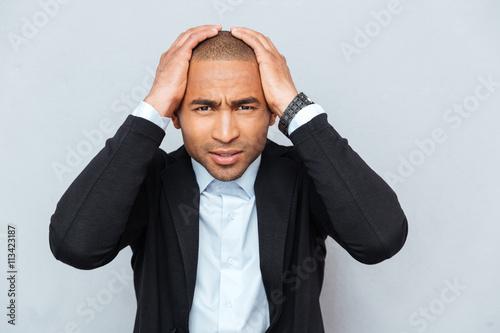 Fotografie, Obraz  Closeup portrait of unhappy upset guy isolated on gray background