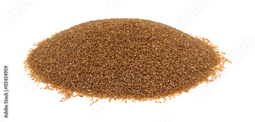 Portion of teff grain isolated on a white background side view.