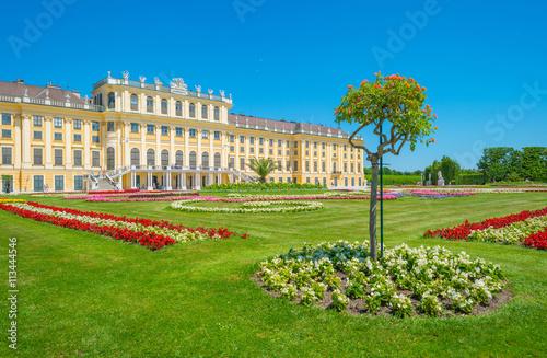 Public palace garden below a blue sky