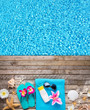Beach accessories on wooden background with pool