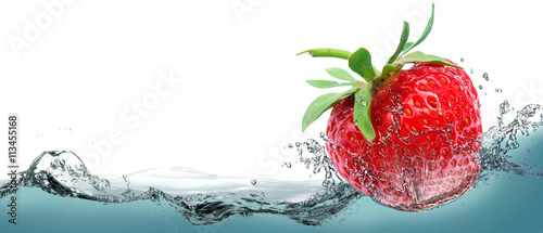 Juicy strawberry on a background of splashing water. Wallpaper Mural