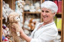 Grandmother Choosing Plush For Her Grandchild