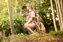 Young Girl Scout, Explores  Nature With Binoculars On Camping Tr