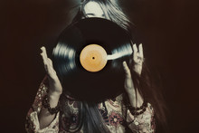 Girl Holding A Vinyl Record