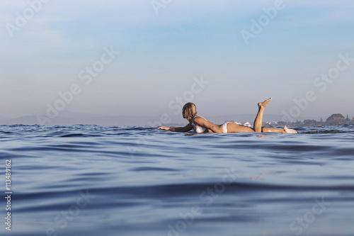 Full length of woman swimming in sea against sky