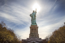 Low Angle View Of Statue Of Liberty Against Sky On Sunny Day