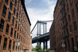 Low angle view of Brooklyn bridge and buildings in city against sky