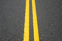 Double Yellow Line On Asphalt ...