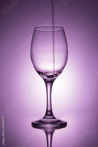 Foto op Plexiglas Bar Water pouring into wine glass