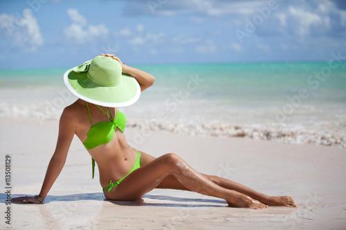 Holiday fashion bikini girl relaxing on Caribbean vacation.