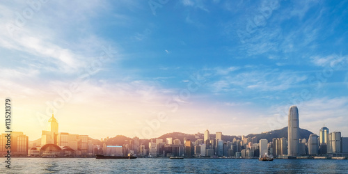 Stampe  Hong Kong's Victoria Harbour in sunrise with text welcome to Hon