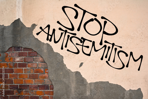 Stop Antisemitism - handwritten graffiti sprayed on the wall, anarchist aesthetics Canvas Print
