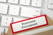 Business Processes. Red Index Card Concept on Background of Modern Metallic Keyboard. Business Concept. Closeup View. Blurred Illustration. 3D Rendering.