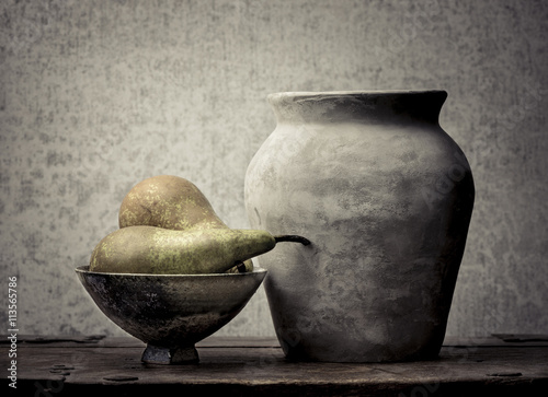 Fototapeta Fruit still life with pears on wooden table. Vintage rustic food image with artistic texture effect. obraz