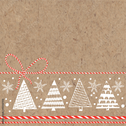 Fotografía  Festive background with Christmas trees and snowflakes on kraft paper