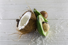 Fresh, Delicious Coconut With Avocado On A Wooden White Background