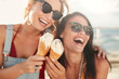 canvas print picture - Female friends having fun and eating ice cream