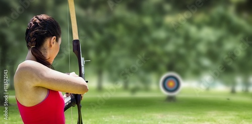 Canvas Print Image of rear view of sportswoman doing archery