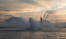 FDNY Boat Spraying Water In Front Of Statue Of Liberty During Ne