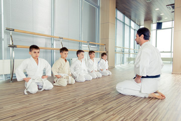 Fototapetayoung, beautiful, successful multi ethical kids in karate position