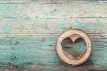 Heart Shape Carved In Wood Cut On The Old Turquoise Boards.