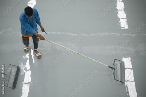 Fotografie, Obraz  A worker application of epoxy floor