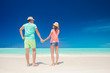 young couple waling at tropical beach