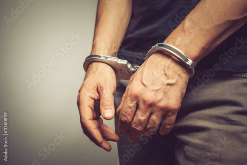 male hands in handcuffs Fototapeta
