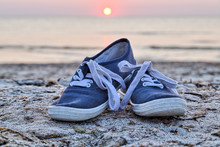 Two Sneakers At The Beach