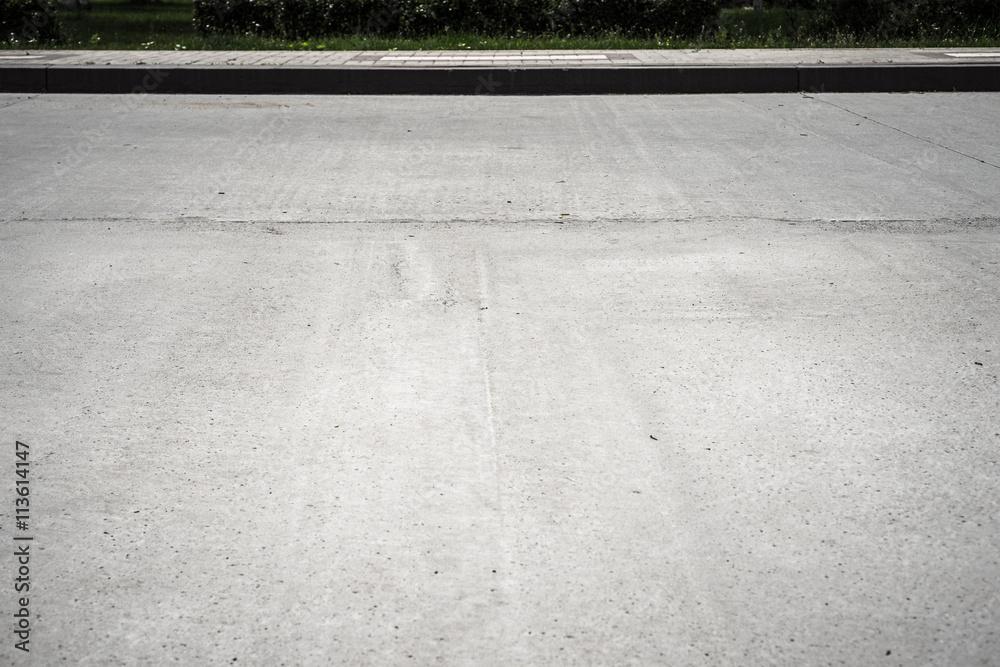 Fototapeta Road with sidewalk background