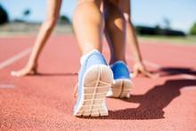 Female Athlete Ready To Run On...