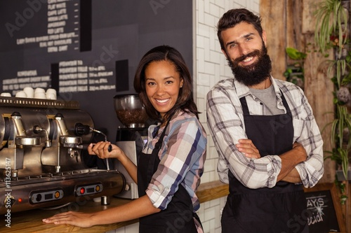 Fotografía Portrait of two waiters with a coffee machine