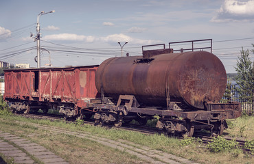 Fototapeta na wymiar Old covered goods wagon and tank car