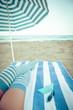 Slim woman legs on a beach