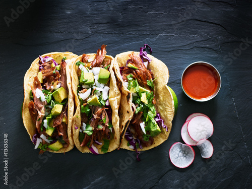 Spoed Foto op Canvas Eten three mexican pork carnitas tacos flat lay composition