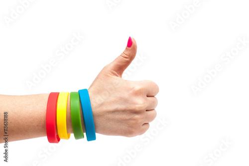 Fotografía  Colored latex bracelet on the arm