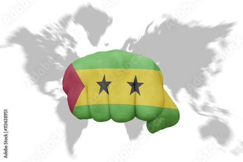 fist with the national flag of zimbabwe on a world map background ...
