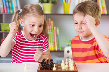 Two Cute Children Playing Chess