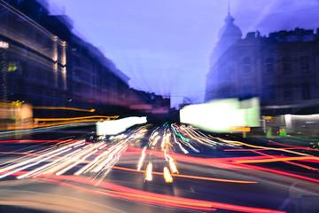 Evening city traffic lights speed blurred  motion