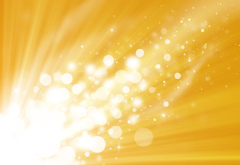 Gold glitter sparkle defocused rays lights bokeh beautiful abstract background.